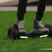 riding a Halo Rover hoverboard on grass